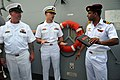 US Navy 110316-N-9818V-340 An Indian navy sailor, right, talks with Ensign Theodore Tom, center, and Chief Boatswain's Mate Timothy Vance during a.jpg