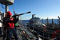 US Navy 110725-N-WA347-220 Fire Controlman 2nd Class Peter Lopez fires the shot line to USNS John Ericsson (T-AO 194) from USS Germantown (LSD 42).jpg