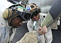 US Navy 110811-N-DS193-008 Aviation Machinist's Mate 1st Class Phillip Carlton, left, and Aviation Electronics Technician 1st Class Corey Clime use.jpg