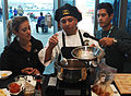 US Navy 111004-N-BX435-067 Yeoman 1st Class Abel Conteras, assigned to Navy Operational Support Center Albuquerque, cooks a chili for the Navy Chil.jpg