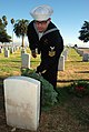 US Navy 111210-N-PQ745-213 Culinary Specialist 1st Class Eric Selberg pays tribute to a fallen soldier following a Wreaths Across America ceremony.jpg