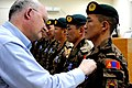 United States Ambassador to Mongolia Jonathan Addleton pins a NATO medal onto a Mongolian counterinsurgency trainer during his visit to Camp Julien, Afghanistan.jpg