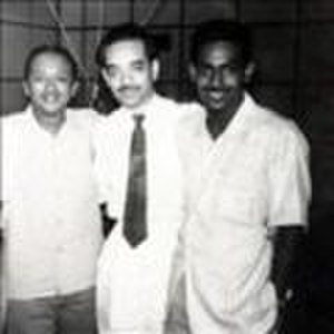 Radio Ceylon - Pioneering broadcaster, Vernon Corea (left) with fellow announcers in a studio at Radio Ceylon, Colombo in 1958.