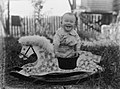 View of a baby on a rocking horse (AM 80589-1).jpg