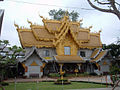 Wat Rong Khun golden toilet building.JPG