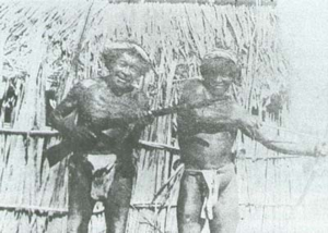 Guajira Peninsula - Wayuus carrying a rifle and traditional bow and arrow. 1928.