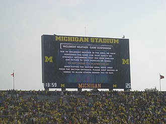 2011 Michigan Wolverines football team - One of Michigan Stadium's scoreboards indicating the first of two weather delays.
