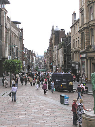 Buchanan Street - Buchanan Street looking southward. The green glass entrance to Buchanan Street subway station is visible through the crowd, and the St. Enoch travel centre can be seen at the far end.