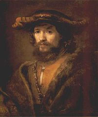Bust of man wearing a large-brimmed hat