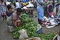 Women in a market selling vegetables.jpg