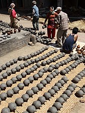 Workers and Clay Pots - Potters' Square - Bhaktapur - Nepal (13508428844).jpg