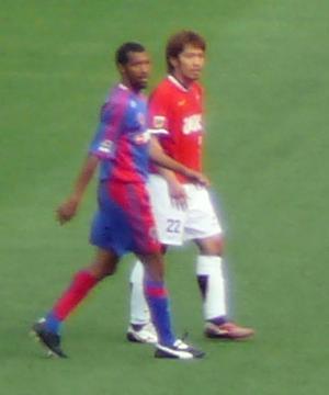 Yuki Abe - Abe (right) playing for Urawa Red Diamonds in 2007