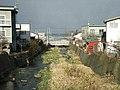 Zenibako River and the Sea of Japan 2004.jpg