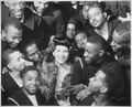 """Surrounded by recruits, Marva Louis, wife of champion Joe (Louis), takes time out from a tour of nightclubs to... - NARA - 535855.tif"
