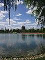 玉门市玉泽湖公园,玉泽湖和远处的楼阁 Yuzehu Park, Yuzehu and the pavilion in the distance, Yumen, Gansu Province, Aug 2017.jpg