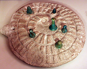 Mehen (game) - Mehen game with gamestones, from Abydos, Egypt, 3.000 BC, Neues Museum
