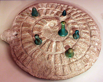 Mehen (game) - Mehen game with game stones, from Abydos, Egypt, 3000 BCE, Neues Museum