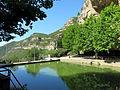 054 Sant Miquel del Fai, estany artificial, al fons els cingles del Perer.JPG