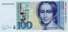 Banknote in light blue with green and beige, focused on the face of a young woman on the right, dark blue drawing on light blue