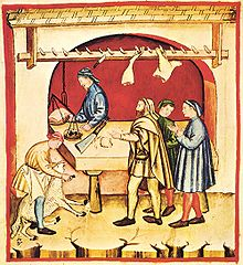 This picture is showing a 14th-century butcher doing his trade in a traditional manner.