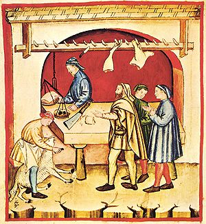 Butcher - A 14th-century butcher performing his trade in a traditional manner from A butcher's, Tacuinum sanitatis casanatensis (XIV (14th) century)