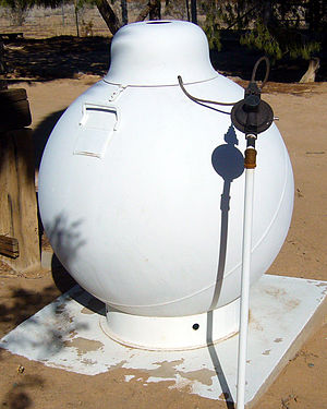 Propane - Domestic spherical steel pressure vessel  with pressure regulator for propane storage in the United States. This example was installed on this property in 1974.