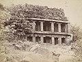1885 photo of two storeyed Buddhist monument and cave at Meguti hill, Aihole Karnataka.jpg