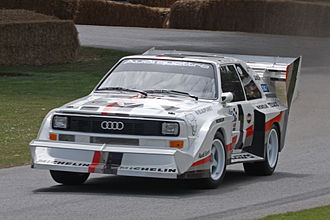 Spoiler (car) - 1987 Audi Sport Quattro S1 with special racing wings and the Pikes Peak International Hill Climb livery, in the Goodwood Festival of Speed