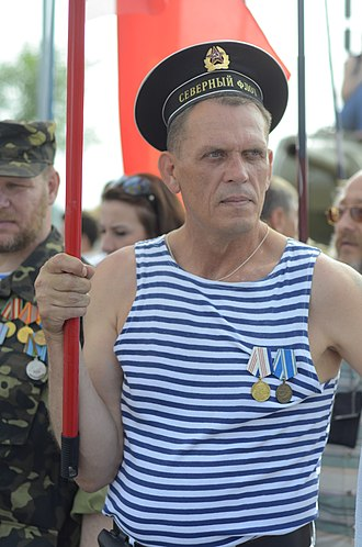 Telnyashka - A man wears a blue, sleeveless telnyashka at a Victory Day celebration in Donetsk.