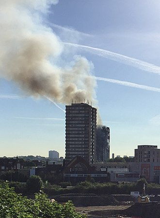 Grenfell Tower fire - In the morning, the smoke plume was still visible over a long distance. (Grenfell Tower is the building behind, Frinstead House is in front.)