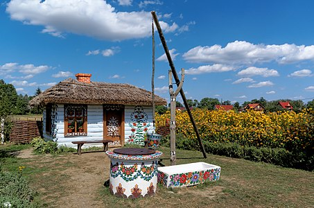 Zalipie - a well and a cottage in the front of the Paintresses' House