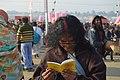 2019 Jan 15 - Prayagraj Kumbh Mela - Reading Holy Booklet.jpg