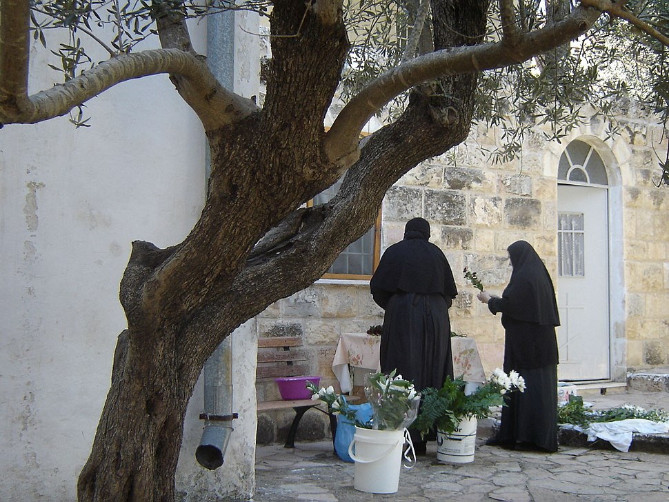 2 nuns arranging flowers