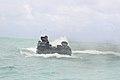 A U.S. Marine Corps amphibious assault vehicle (AAV) tears through the waves off the coast of Marine Corps Training Area Bellows, Hawaii, Aug. 25, 2009 090825-M-KL398-002.jpg