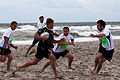A U.S. Marine for the Cherry Point rugby team digs in trying to outrun players from the all-Irish team during the 2nd annual Blackbeard 7s Beach U.S. Open Rugby Championship Tournament at Atlantic Beach 120811-M-XK427-002.jpg