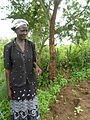 A beneficiary explaining about the benefits of the fertiliser (7608504544).jpg