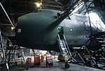 A camouflaged USAF C-5A Galaxy aircraft in a hangar for inspection and maintenance Dover AFB.jpg