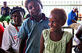 A family sits around at Honiara Central Market. (10661698764).jpg