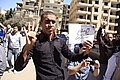 A protester holds up four-fingers as R4bia hand sign in memory of last 2013 deadly crackdown on supporters of ousted President Morsi - Cairo - 28-Mar-2014.jpg