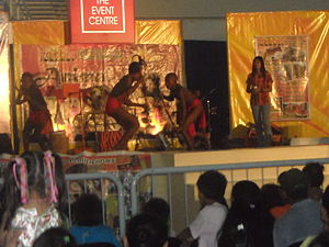 Luzon rainforest - Agta people performing on a stage.