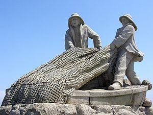 Galego: Estatua en Aguiño, Ribeira, Galiza