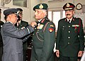 Air Commodore Sanjay Sharma of Kendriya Sainik Board, pinning the lapel on the Chief of Army Staff, General V.K. Singh, on the occasion of the Armed Forces Flag Day, in New Delhi on December 07, 2011.jpg