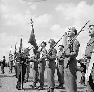 Joseph Van De Meulebroeck - Joseph Van de Meulebroeck presents colours to the British Guards Armoured Division at the victory parade in Brussels in 1945