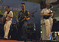 An Indonesian navy band member plays along with U.S. Navy Musician 3rd Class Charlie Perkes, left, and Musician 3rd Class Chris Kopp at a public performance at the Artha Gading Mall in Jakarta, Indonesia 090826-N-WL717-267.jpg