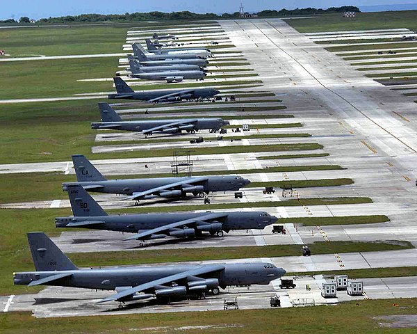 Air Force fighters, bombers, tankers and air control aircraft occupy the flightline at Andersen Air Force Base, Guam. The aircraft, deployed from several Air Force bases, are here to promote regional security and stability in the region. (U.S. Air Force photo/Airman 1St Class Cory Todd)