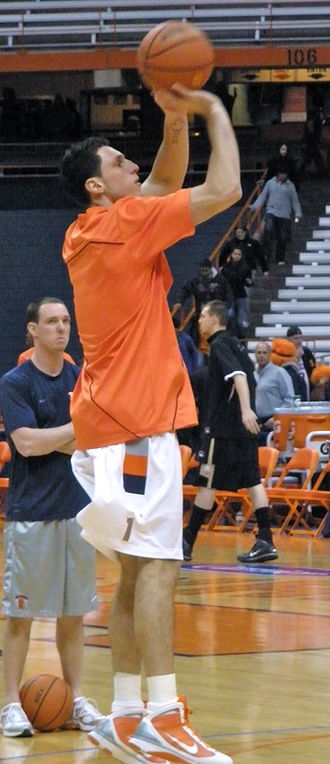 Andy Rautins - Rautins during warmups before a game at Syracuse University's Carrier Dome with Assistant Coach and former Syracuse Orange Basketball player Gerry McNamara watching.