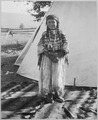 Angelic La Moose, whose grandfather was a Flathead chief, wearing costume her mother made, full-length, standing, in fro - NARA - 519156.tif