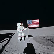 Astronaut Alan Shepard raises the United States Flag on the surface of the moon during the Apollo 14 mission.