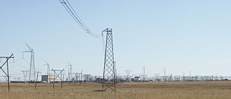 Cahora Bassa (HVDC) - The Apollo HVDC converter station and distribution lines. The Cahora Bassa HVDC line can be seen as the tall pylons on the left. The line in the centre of the picture with a single conductor is the electrode line of HVDC Cahora Bassa