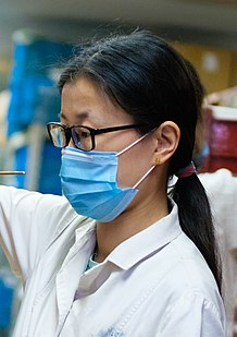 Apothecary wearing a surgical mask (cropped).jpg